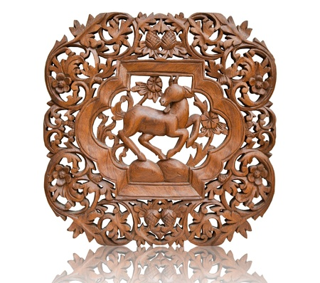 wood carvings: Pattern Thai art carving on wood, goat  Stock Photo