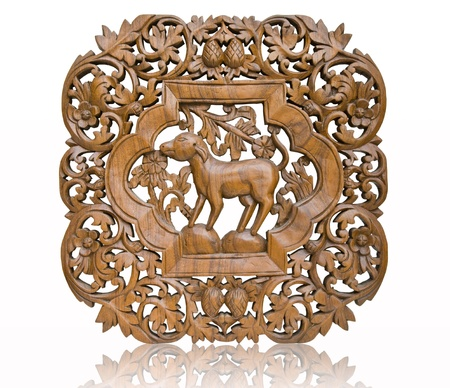 wood carvings: Pattern Thai art carving on wood, dog  Stock Photo