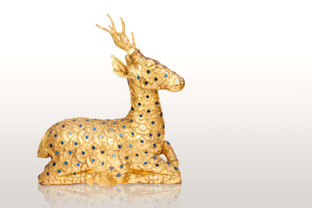 Golden deer sculpture isolated on white Stock Photo - 19676626