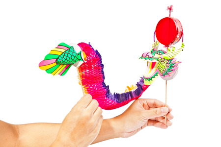 chinese new year dragon: Paper dragon puppet isolated on white
