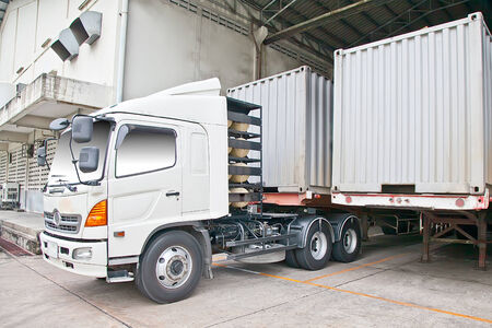 warehouse building: Container truck at warehouse building Stock Photo