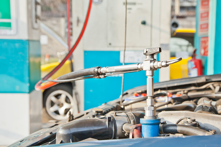 ngv: Refill CNG gas at fuel station for cars  Stock Photo
