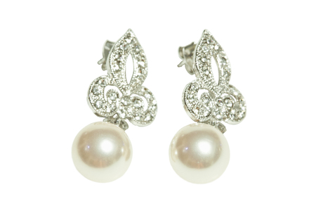 Pearl diamond earrings isolated on white