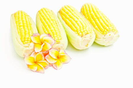 shucked: Corn and flowers isolated on white
