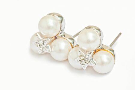 diamond earrings: Pearl diamond earrings isolated on white