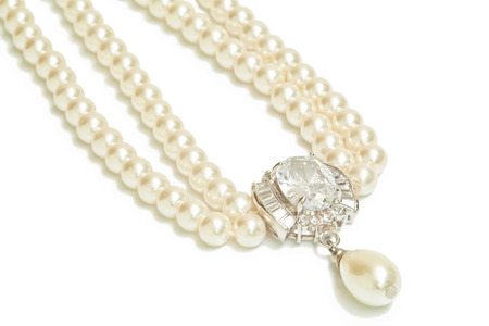 pearl: Diamond and pearl necklace isolated on white