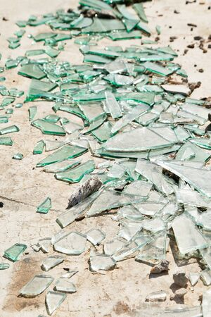 shards: Broken mirror glass shards spread on the floor