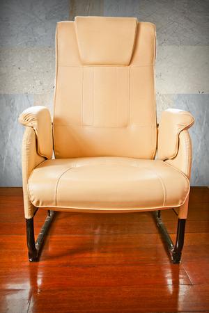 wood floor: Brown leather chairs on wood floor