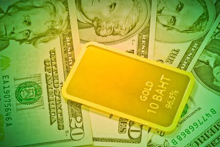 speculative: Gold bars and usa dollar