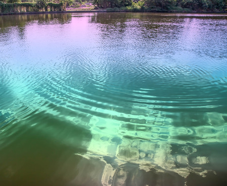liquid reflect: Reflections of sky on rippled water surface