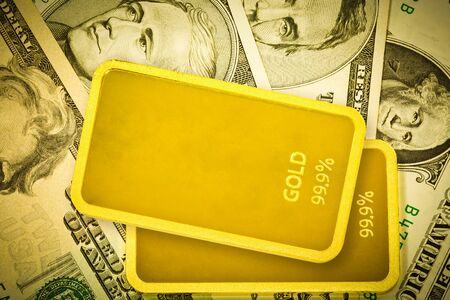 speculate: gold bars and dollar Stock Photo