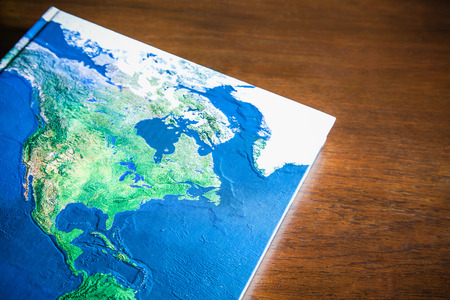 wood table: World map book on wood table