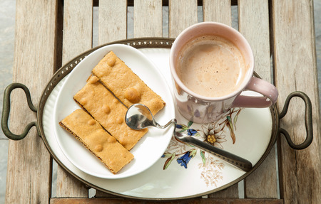 stick of cinnamon: Hot drinks and biscuits on the table