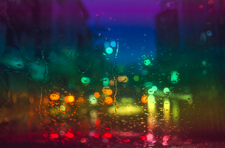 car glass: Raindrops on car glass at night