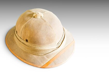 pith: Old pith helmet isolated on gray