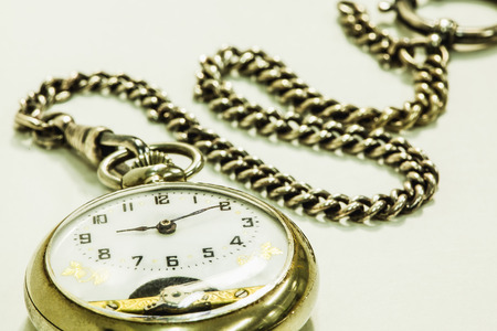pocket watch: Silver pocket watch isolated on white