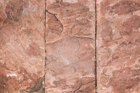 road paving: Natural red pavement stone for floor, wall or path. Traditional fence, court, backyard or road paving. Stock Photo