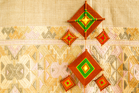 Fabric mobile in front of fabric pattern background, Handicraft