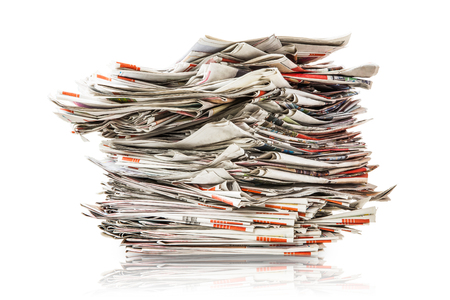 Pile of old folding newspapers isolated on white