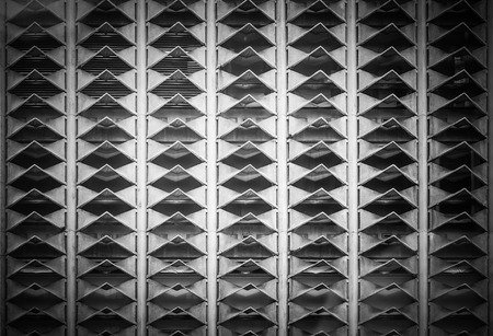 ventilated: Abstract close-up view ventilated triangles on facade of building
