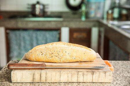 Whole grain bread with a knife