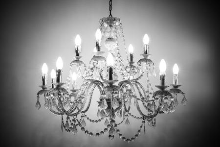 Beautiful chandelier light on dark background
