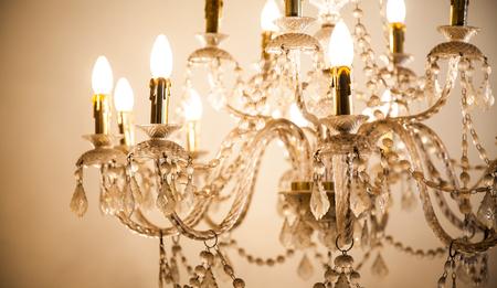 chandelier background: Beautiful chandelier light on dark background