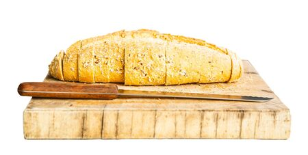 Whole grain bread with a knife isolated on white Stock Photo