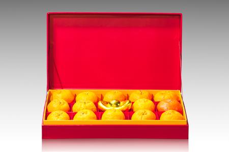 Orange fruit in red box, Chinese gift box