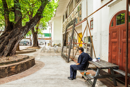 The old man sat at the table under the tree Stok Fotoğraf