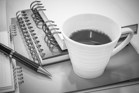 Notebook with elegant pen and cup of hot coffee, Backgrounds