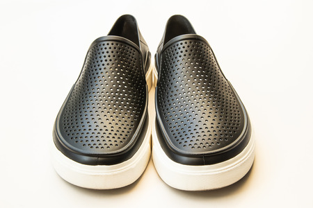 Mens fashion black rubber shoes, Casual design isolated on white 版權商用圖片