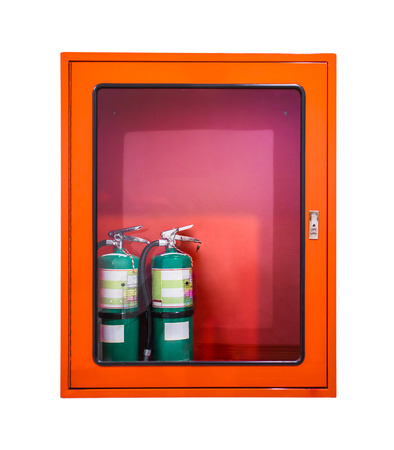 Two green fire extinguishers is in the red cabinet Stock Photo