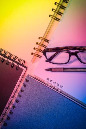 Close up pen eyeglasses and spiral notebook, Pattern background Stok Fotoğraf