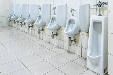 White porcelain urinals in clean, Public toilets backgrounds