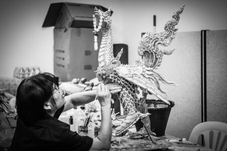Artist painted on bird statues in Thai literature at the Fine Arts Department, Sanam Luang, Bangkok, Thailand, September 14, 2017