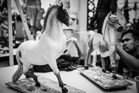 Artist painted on horses statues in Thai literature at the Fine Arts Department, Sanam Luang, Bangkok, Thailand, September 14, 2017