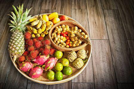 Fruits in basket on wooden floor