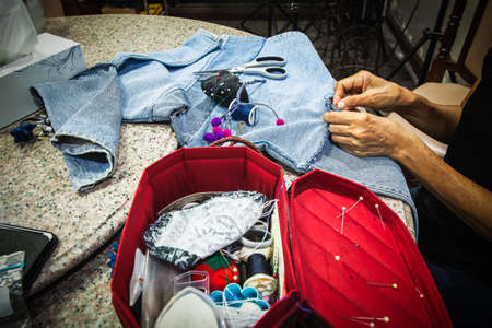 Women were sewing shirts in the house, Backgrounds Banco de Imagens