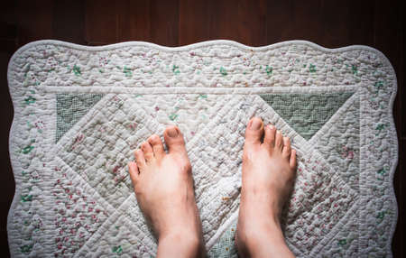 Male asian feet on the doormat, Backgrounds