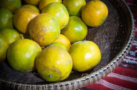 An old basket full of fresh orange fruits, Backgrounds