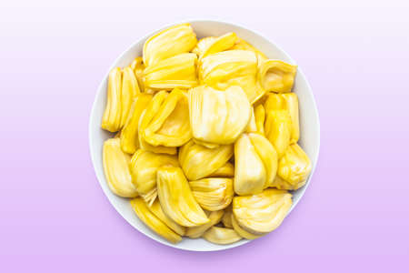 Jackfruit in a white bowl isolated on purple background