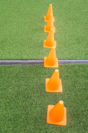 Orange cones on green artificial grass, Pattern backgrounds