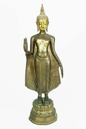 Front side of ancient Buddha metal statue isolated on white background