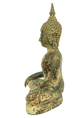 Lateral side of ancient Buddha metal statue isolated on white background Banco de Imagens