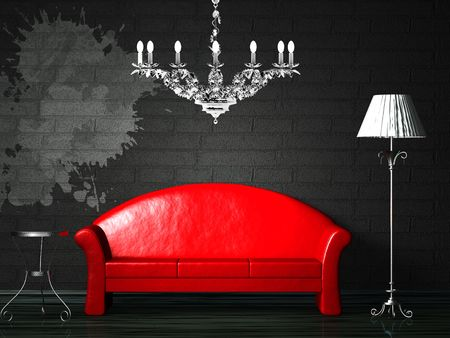Red couch with splash on the black wall and luxury chandelier  photo