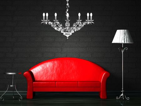 Red couch with table, standard lamp and luxury chandelier photo