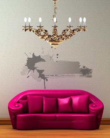 Pink couch with golden chandelier and splash frame in minimalist interior photo