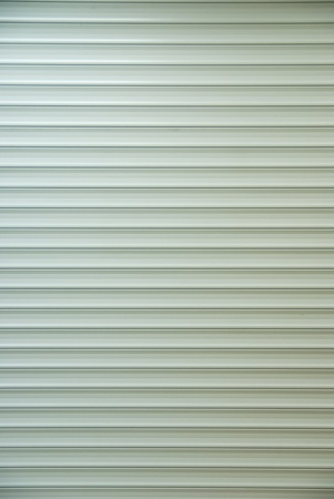 Galvanized Steel Roller Shutter Door, suitable for use as industrial background.          photo