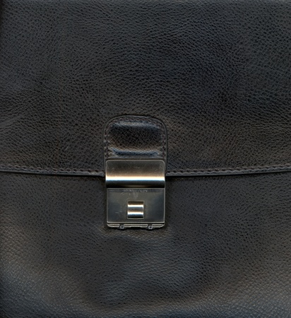 graining: Black leather background textured with graining patterns and lock Stock Photo